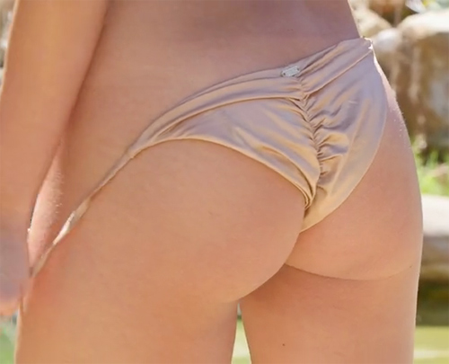 Alexandra unties her bikini bottoms, they will soon hit the floor