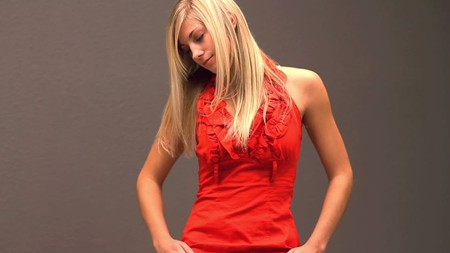 A blonde beauty in a red top