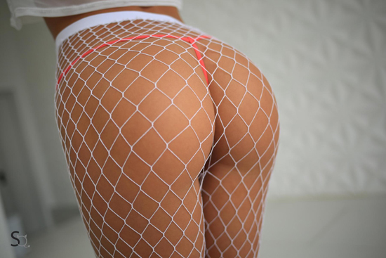 She's wearing sexy fishnet tights