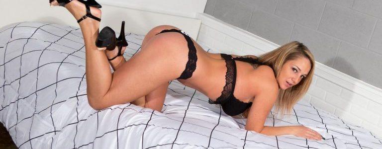 Nikki Sims teasing on her bed